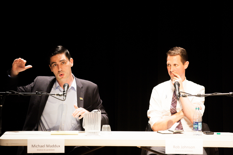 Seattle City Council District 4 candidate Michael Maddux responds to a panel question as rival candidate Rob Johnson listens in the background during a debate in Wallingford on October 14, 2015.